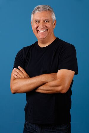 middle age man: Handsome middle age man portrait with a blue background.