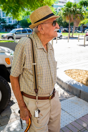 Elderly 80 plus year old man in a outdoor setting.