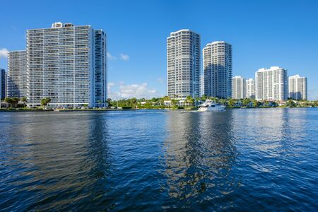 condo: North Miami Intracoastal Waterway with a yacht cruising by and condominiums.