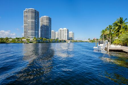 waterfront property: North Miami Intracoastal Waterway with condominiums and boats cruising by. Stock Photo