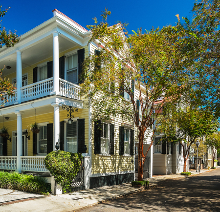Historic southern style homes in Charleston, South Carolina with fall colors. Stock Photo