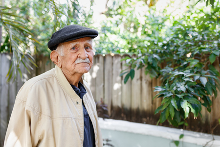 aging american: Elderly eighty plus year old man in a outdoor setting.
