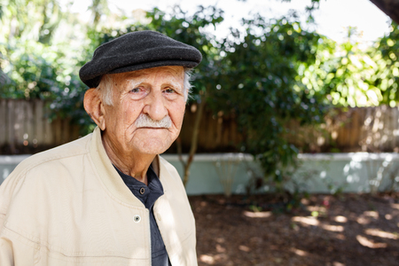 octogenarian: Elderly eighty plus year old man in a outdoor setting.