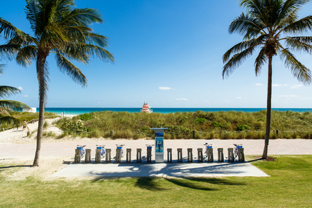 rentals: Miami Beach, Florida USA - February 25, 2016: Beautiful clear blue sky day in scenic and popular Miami Beach with Citibike rentals along the promenade.
