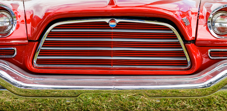 restored: Miami, Florida USA - February 28, 2016: Close up view of the front end of a beautifully restored American Chrysler automobile.