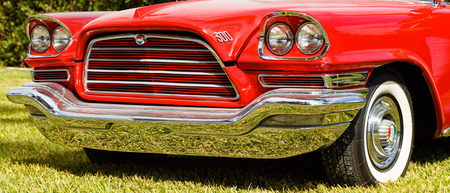 front end: Miami, Florida USA - February 28, 2016: Close up view of the front end of a beautifully restored American Chrysler automobile.