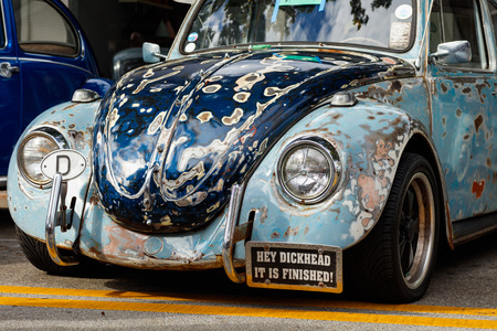 front end: Miami, Florida USA - February 28, 2016: Close up view of the front end of a vintage unrestored German Volkswagen Beetle.