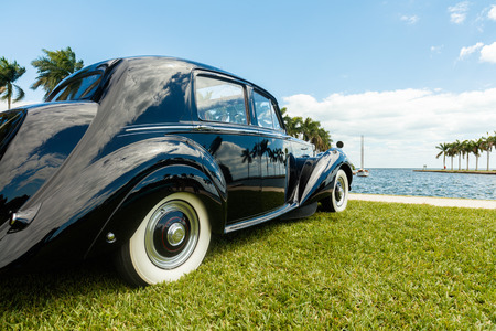 Miami, FL USA - February 28, 2016: Beautifully restored 1952 Rolls Royce automobile in a outdoor park setting along the bay.