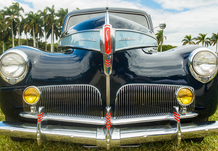 commander: Miami, FL USA - February 28, 2016: Close up view of the front end of a beautifully restored vintage 1941 Studebaker Commander automobile.