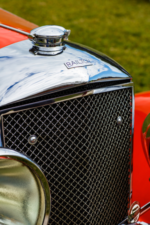 restored: Miami, Florida USA - February 28, 2016: Close up view of the front end of a beautifully restored 1936 Railton Tourer automobile.