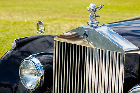 ifestyle: Miami, FL USA - February 28, 2016: Beautifully restored 1952 Rolls Royce automobile in a outdoor park setting along the bay.
