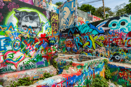 destination scenics: Austin, Texas USA - April 8, 2016: Colorful graffiti on the walls of the popular Hope Outdoor Gallery on Baylor Street near downtown Austin.
