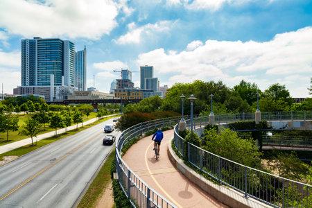 Austin, Texas USA - April 14, 2016: The Lamar Street Pedestrian Bridge  is a popular thoroughfare over the Colorado River in the downtown area.