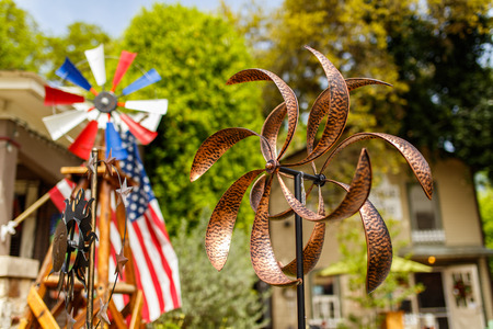 small country town: Wimberley, Texas USA - April 6, 2016: Colorful shop with artwork and vintage items on display in the small Texas Hill Country town of Wimberley.