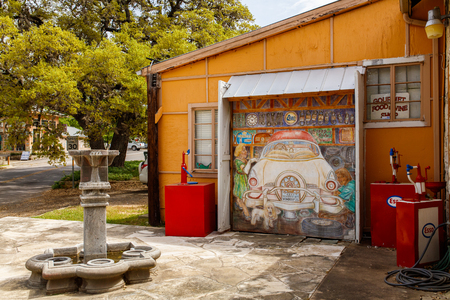 small country town: Wimberley, Texas USA - April 6, 2016: Colorful graffiti on the side of a retail shop in the small Texas Hill Country town of Wimberley.