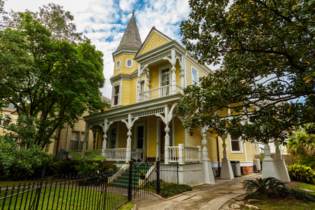 united states: New Orleans, LA USA - April 21, 2016: Beautifully restored vintage Victorian style home on historic Saint Charles Avenue.