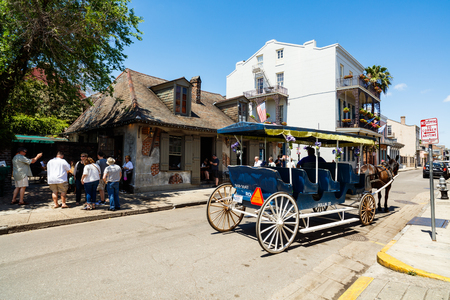 bourbon street: New Orleans, LA USA - April 22, 2016: Carriage ride waiting for tourists on Bourbon Street in the French Quarter district. Editorial