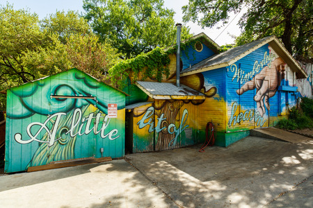 small country town: Wimberley, Texas USA - April 6, 2016: Colorful graffiti on the side of a building in the small Texas Hill Country town of Wimberley. Editorial