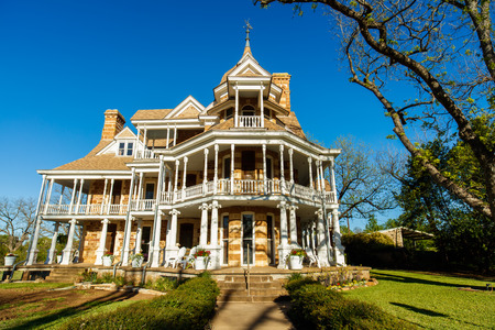 country house style: Mason, Texas USA - April 2, 2016: The Seaquist House, built in 1896, is a beautiful Victorian style historical home in this small Texas town in the hill country. Editorial