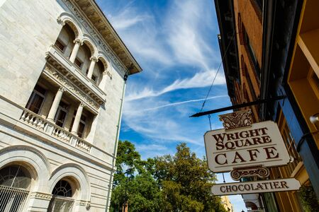 historic district: Savannah, GA USA - April 25, 2016: The Wright Square Cafe sign and the classic architecture of the downtown historic district. Editorial
