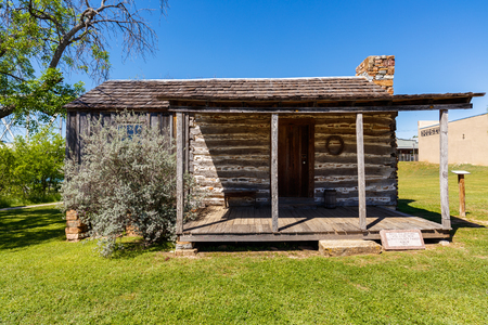 small country town: Llano, Texas USA - April 3, 2016: A vintage restored rustic log style home in the small Texas Hill Country town of LLano. Editorial