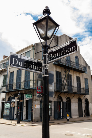 street sign: New Orleans, LA USA - April 20, 2016: Intersection of Bourbon and Dumaine Street in the historic district of the French Quarter.