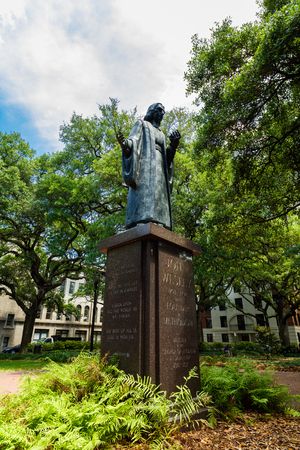 reynolds: Savannah, GA USA - April 25, 2016: John Wesley, founder of Methodism, statue in Reynolds Square Park in the popular historic district. Editorial