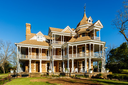 red brick: Mason, Texas USA - April 2, 2016: The Seaquist House, built in 1896, is a beautiful Victorian style historical home in this small Texas town in the hill country. Editorial