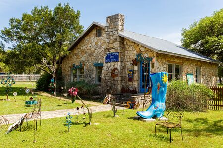 small country town: Wimberley, Texas USA - April 6, 2016: Colorful boot art sculpture on display in the small Texas Hill Country town of Wimberley. Editorial