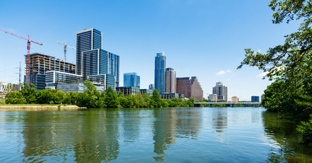 green office: Austin, TX USA - April 14, 2016: Skyline view of downtown Austin from the Colorado River with new construction along Cesar Chavez Street.