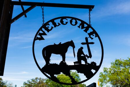 southwestern: Llano, Texas USA - April 5, 2016: Vintage welcome business sign in the small Texas Hill Country town of LLano. Editorial