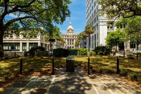 historic district: Savannah, GA USA - April 25, 2016: Johnson Square Park in the popular historic district with the City Hall in the background. Editorial