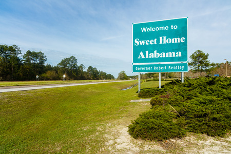 destination scenics: Mobile, Alabama USA - March 30, 2016: Welcome sign entering the state of Alabama westbound from Florida along Interstate 10 near Mobile.