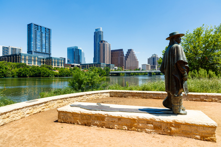 colorado skyline: Austin, TX USA - April 14, 2016: Skyline view of the downtown district along the Colorado River with the statue of the late Stevie Ray Vaughan. Editorial