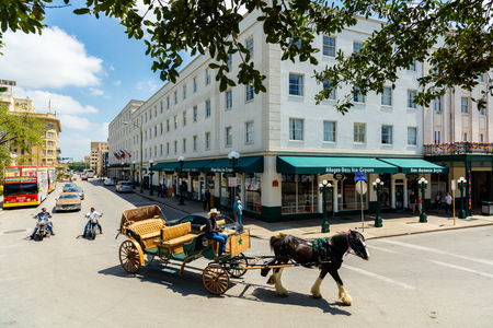 tx: San Antonio, TX USA - April 15, 2016:  A classic horse carriage ride in the downtown historic Alamo district.