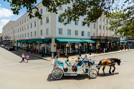 horse and carriage: San Antonio, TX USA - April 15, 2016: Visitors enjoying a horse carriage ride in the historic Alamo district.