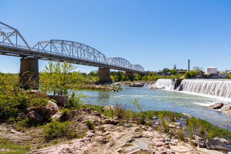 small country town: Llano, Texas USA - April 3, 2016:  The rustic Highway 71 bridge over the Llano River in the small Texas Hill Country town of LLano.