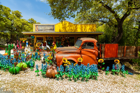 small country town: Wimberley, Texas USA - April 6, 2016: Colorful shop with artwork on display in the small Texas Hill Country town of Wimberley. Editorial