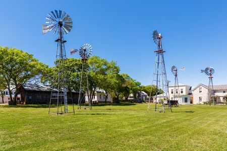 influenced: Fredericksburg, Texas USA - April 3, 2016: The Pioneer Museum with tall windmills in the rustic and German influenced town of Fredericksburg in the hill country. Editorial