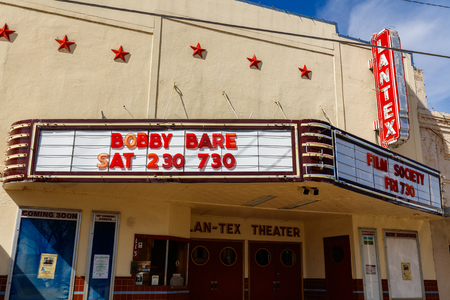small country town: Llano, Texas USA - April 5, 2016:  Vinatge theater signs in the small Texas Hill Country town of LLano. Editorial