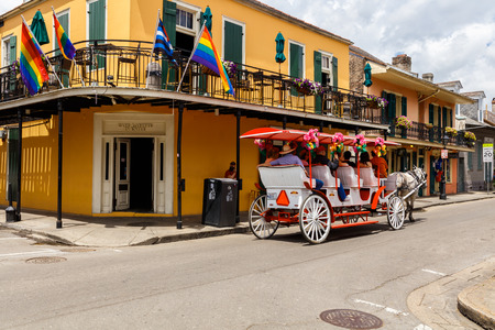horse and carriage: New Orleans, LA USA - April 20, 2016: Visitors enjoying a horse carriage ride in the historic French Quarter district.