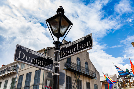 bourbon street: Street signs and architecture of the French Quarter in New Orleans, Louisiana. Stock Photo
