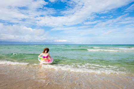 fair complexion: Pretty middle age woman enjoying beautiful Miami Beach. Stock Photo