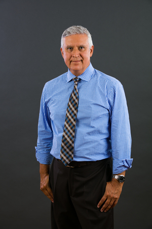 sex appeal: Handsome middle age business man portrait on a gray background. Stock Photo