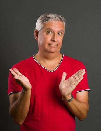 middle age man: Handsome middle age man studio portrait on a gray background.