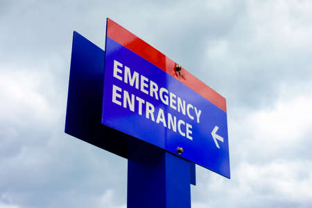 Close up view of a colorful hospital emergency room sign.