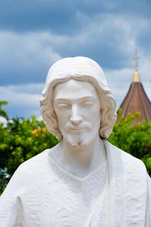 Statue of Jesus Christ in a garden. Stock Photo