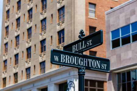 street signs: Downtown Savannah, Georgia cityscape with street signs.