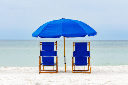 lounge: Beautiful North Florida panhandle beach with lounge chairs and umbrella.