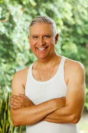 middle age man: Handsome middle age man outdoor portrait with a green background.